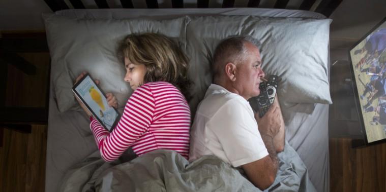 o-couple-apart-bed-facebook